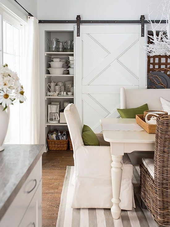 STUNNING white sliding barn doors for this dining room closet.  Beautiful rustic farmhouse feel yet clean and classic too.