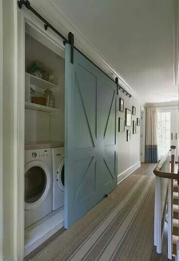 Rustic sliding barn doors used as laundry room doors - fantastic look!