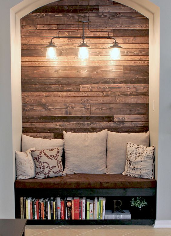 What A Clever Idea These Homeowners Created Reading Nook In Their Living Room And Used Pallet Wood As The Decorative Eye Catching Wall Behind